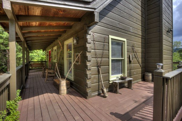 Side porch at Wonders in the Sky, a 3 bedroom cabin rental located in Gatlinburg