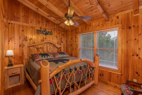 Log bed at Wonders in the Sky, a 3 bedroom cabin rental located in Gatlinburg