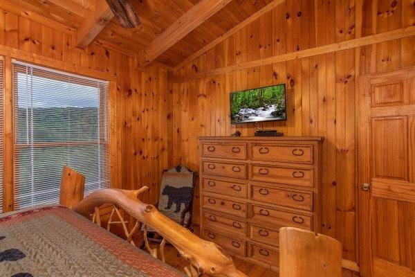 Dresser and TV in a bedroom at Wonders in the Sky, a 3 bedroom cabin rental located in Gatlinburg