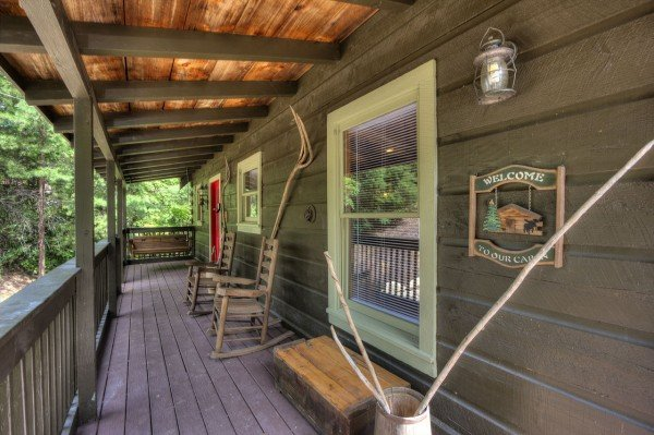 Welcoming front porch with rocking chairs at Wonders in the Sky, a 3 bedroom cabin rental located in Gatlinburg