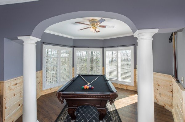 Pool table in a nook at The Majestic, an 8 bedroom cabin rental located in Gatlinburg