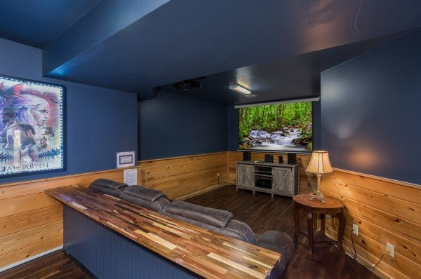 Theater room with counter and sofa seating at The Majestic, an 8 bedroom cabin rental located in Gatlinburg
