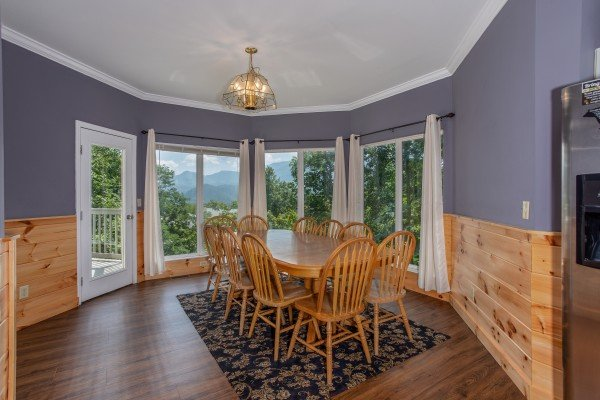 Dining space for 10 at The Majestic, an 8 bedroom cabin rental located in Gatlinburg