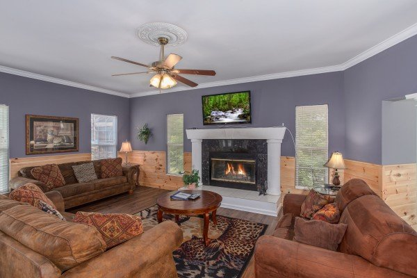 Living room with fireplace and TV The Majestic, an 8 bedroom cabin rental located in Gatlinburg
