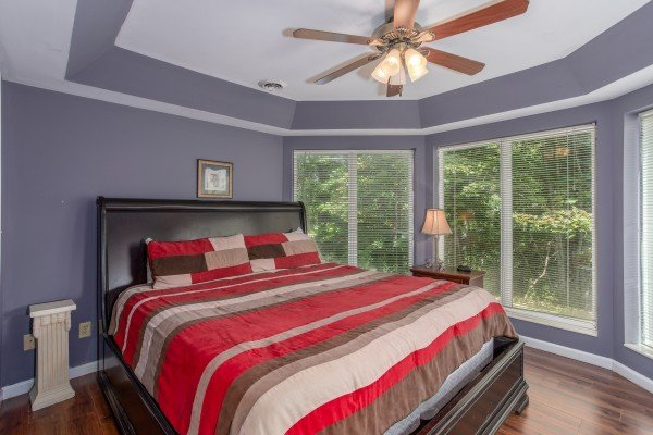 Bedroom with a king bed at The Majestic, an 8 bedroom cabin rental located in Gatlinburg