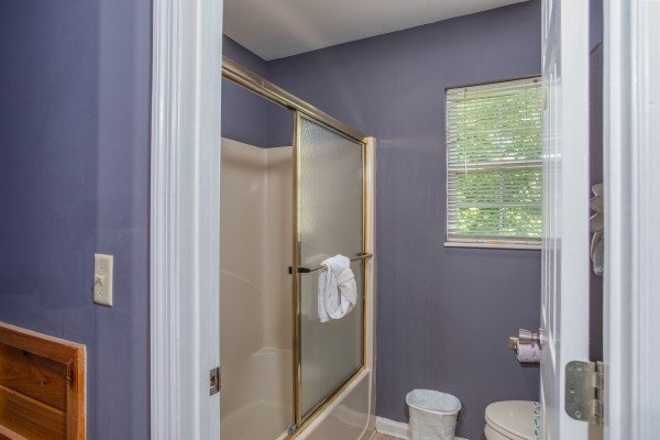 Bathroom with a tub and shower at The Majestic, an 8 bedroom cabin rental located in Gatlinburg