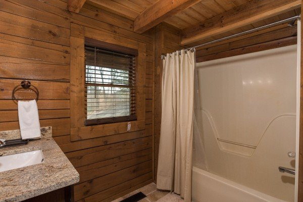 Bathroom with a tub and shower at Makin Memories, a 1 bedroom cabin rental located in Pigeon Forge