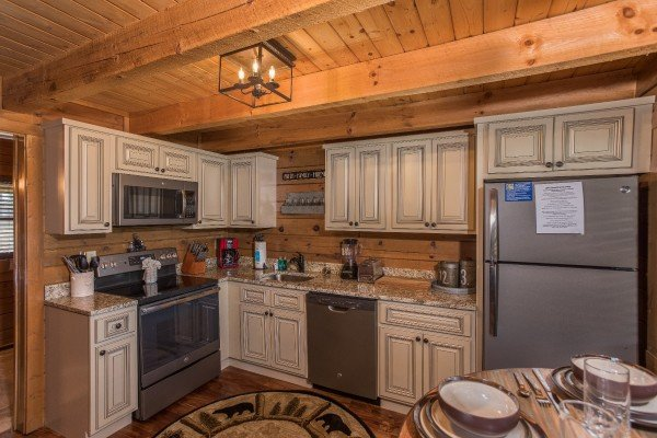Kitchen with stainless appliances at Makin Memories, a 1 bedroom cabin rental located in Pigeon Forge
