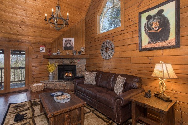 Living room with a fireplace at Makin Memories, a 1 bedroom cabin rental located in Pigeon Forge