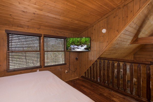 Loft bedroom with a TV at Makin Memories, a 1 bedroom cabin rental located in Pigeon Forge