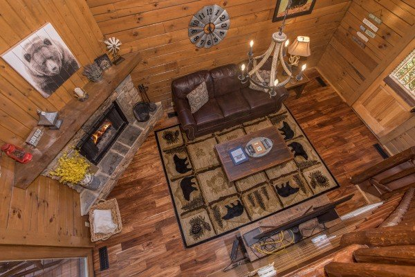Looking down onto the living room from the upper floor at Makin Memories, a 1 bedroom cabin rental located in Pigeon Forge