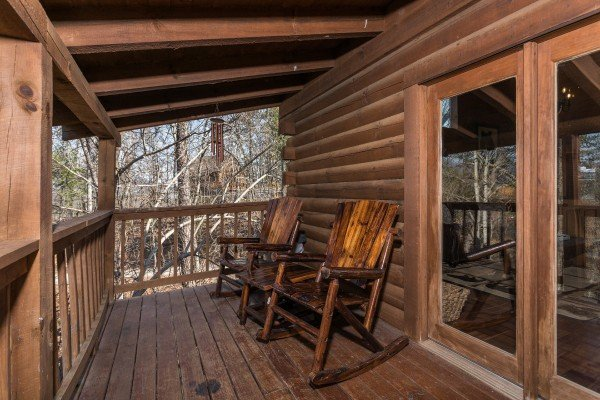 Rocking chairs on a covered porch at Makin Memories, a 1 bedroom cabin rental located in Pigeon Forge