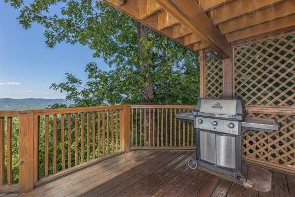 Grill on the covered deck at Eagles View Lodge, a 3 bedroom cabin rental located in Gatlinburg