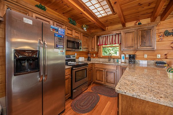 Kitchen with granite counters and stainless appliances at Eagles View Lodge, a 3 bedroom cabin rental located in Gatlinburg