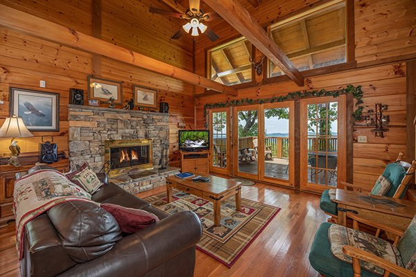 Living room with fireplace & tv at Eagles View Lodge, a 3 bedroom cabin rental located in Gatlinburg