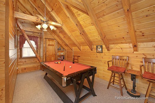Lofted game room at Eagle's View Lodge, a 3-bedroom cabin rental located in Gatlinburg