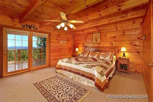 Main floor bedroom with king sized bed at Eagle's View Lodge, a 3-bedroom cabin rental located in Gatlinburg