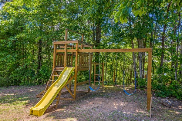 Playground set in the yard at Eagles View Lodge, a 3 bedroom cabin rental located in Gatlinburg