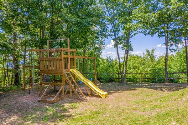Swingset in the yard at Eagles View Lodge, a 3 bedroom cabin rental located in Gatlinburg