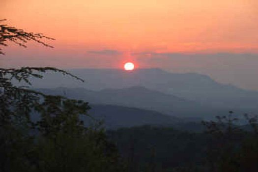 Sunset across the smokey mountains seen from Eagle's View Lodge, a 3-bedroom cabin rental located in Gatlinburg