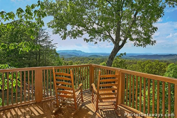 Two rocking chairs on the deck, overlooking the Smoky Mountains at Eagle's View Lodge, a 3-bedroom cabin rental located in Gatlinburg