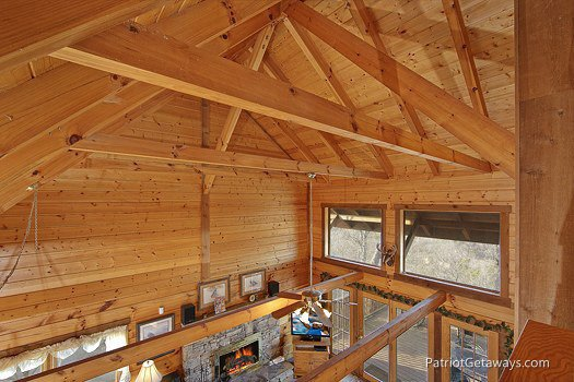 Wood beams supporting the room seen from the lofted bedroom at Eagle's View Lodge, a 3-bedroom cabin rental located in Gatlinburg
