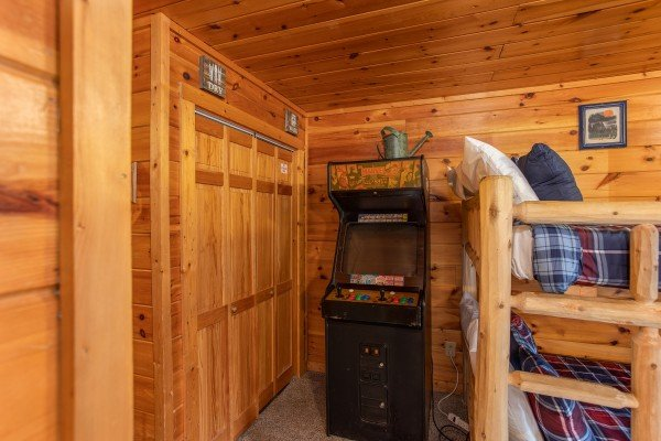 Arcade game in the game room at Hibernation Station, a 3-bedroom cabin rental located in Pigeon Forge