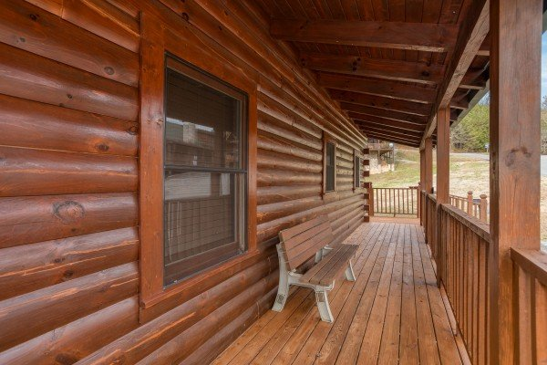 Bench on the deck at Hibernation Station, a 3-bedroom cabin rental located in Pigeon Forge
