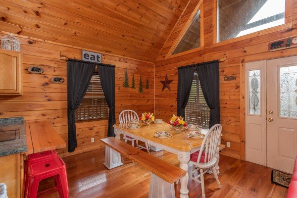 Seating for six at the dining room table at Hibernation Station, a 3-bedroom cabin rental located in Pigeon Forge