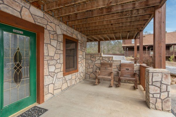 Front porch with two rocking chairs at Hibernation Station, a 3-bedroom cabin rental located in Pigeon Forge