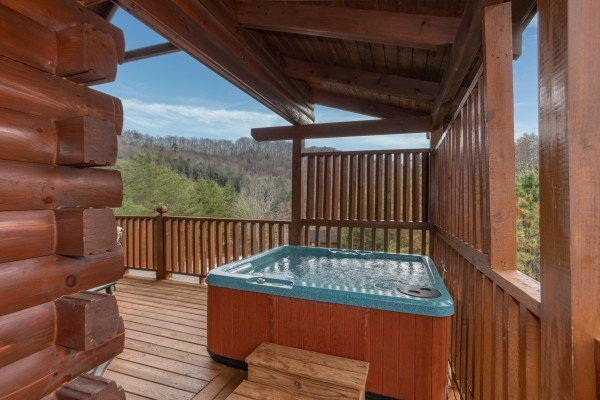 Hot tub and privacy lattice at Hibernation Station, a 3-bedroom cabin rental located in Pigeon Forge