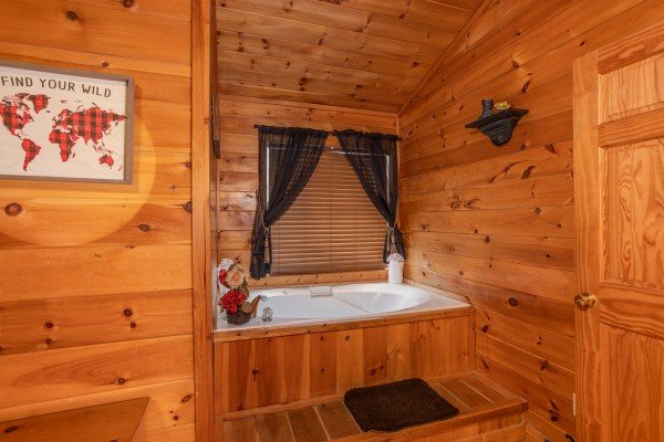 Jacuzzi tub in the upper bedroom at Hibernation Station, a 3-bedroom cabin rental located in Pigeon Forge