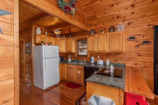 Fully equipped kitchen at Hibernation Station, a 3-bedroom cabin rental located in Pigeon Forge