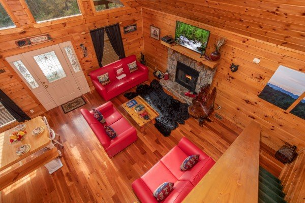 Looking down into the living room from the upper floor at Hibernation Station, a 3-bedroom cabin rental located in Pigeon Forge