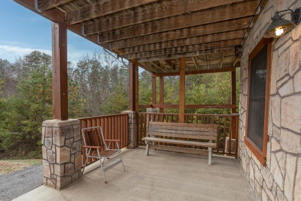 Porch access from the lower floor at Hibernation Station, a 3-bedroom cabin rental located in Pigeon Forge