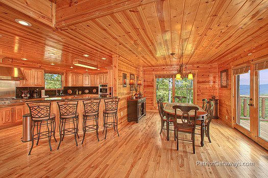 Breakfast bar and dining room table at Majestic Views, a 3 bedroom cabin rental located in Pigeon Forge