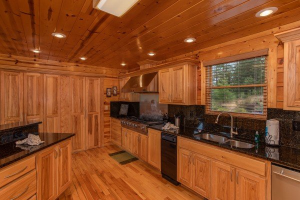Kitchen with stainless appliances and black granite counter tops at Majestic Views, a 3 bedroom cabin rental located in Pigeon Forge