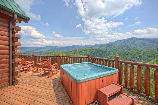 Deck with hot tub at Majestic Views, a 3 bedroom cabin rental located in Pigeon Forge