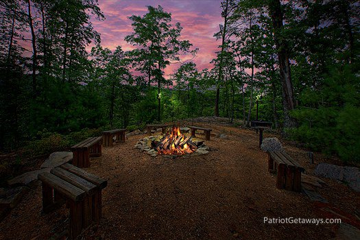 Fire pit and grill at Majestic Views, a 3 bedroom cabin rental located in Pigeon Forge