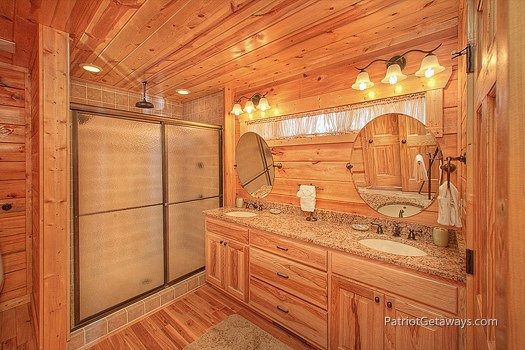 King bedroom attached bath at Majestic Views, a 3 bedroom cabin rental located in Pigeon Forge