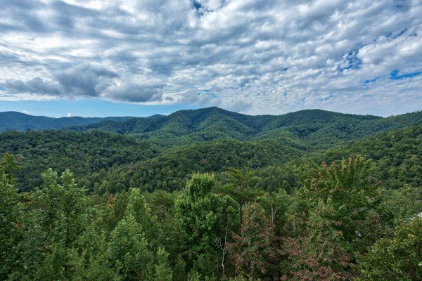Looking out onto the Smoky Mountains at Majestic Views, a 3 bedroom cabin rental located in Pigeon Forge