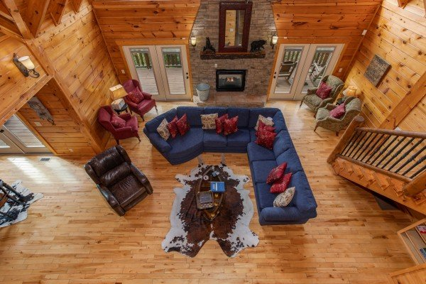 Looking down into the living room from the upper floor at Majestic Views, a 3 bedroom cabin rental located in Pigeon Forge