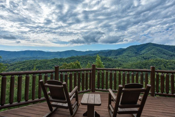 Rocking chairs looking out on the Smoky Mountain views at Majestic Views, a 3 bedroom cabin rental located in Pigeon Forge
