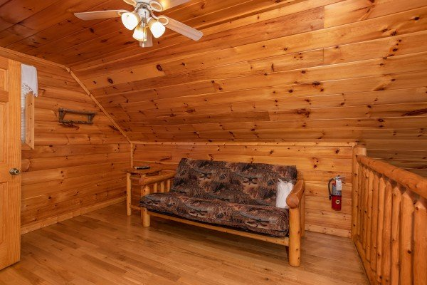 Futon in the loft at Can't Bear to Leave, a 1-bedroom cabin rental located in Gatlinburg