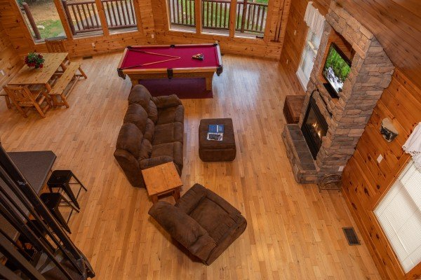 Looking down into the open concept great room at Can't Bear to Leave, a 1-bedroom cabin rental located in Gatlinburg
