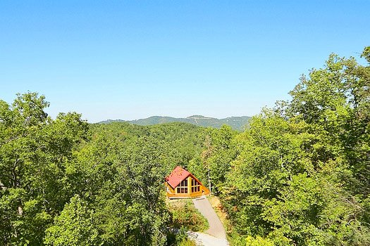 View of property with mountain landscape in the background at Can't Bear to Leave, a 1-bedroom cabin rental located in Gatlinburg
