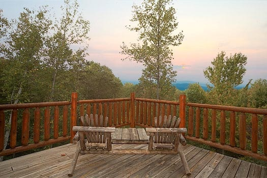 enjoy the view from the seating on the deck at dear season a 1 bedroom cabin rental located in gatlinburg