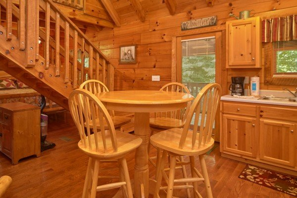 Dining table for four in the kitchen at Wild Crush, a 1 bedroom cabin rental located in Pigeon Forge