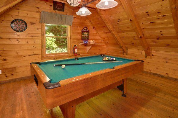 Pool table in the game loft at Wild Crush, a 1 bedroom cabin rental located in Pigeon Forge
