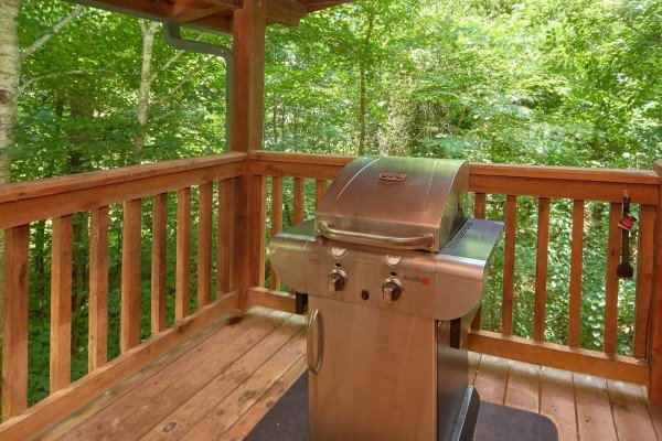 Grill on the covered deck at Wild Crush, a 1 bedroom cabin rental located in Pigeon Forge